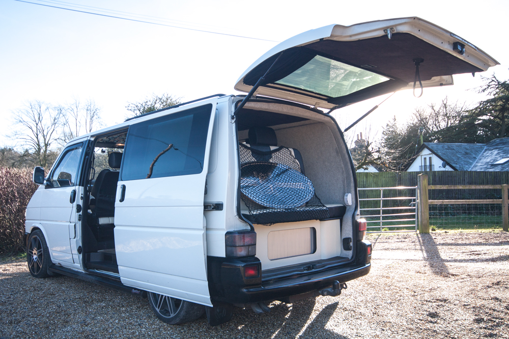 The back of the van, with storage under the bed
